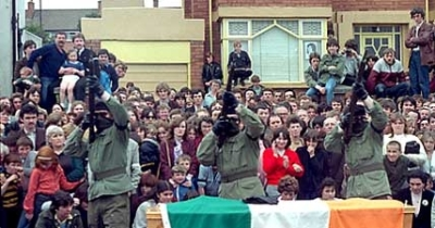IRA Volunteers fire a volley over the coffin of Joe McDonnell