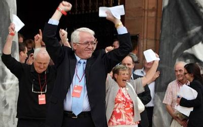 Families celebrate as the Saville Report is published at Derry's Guildhall